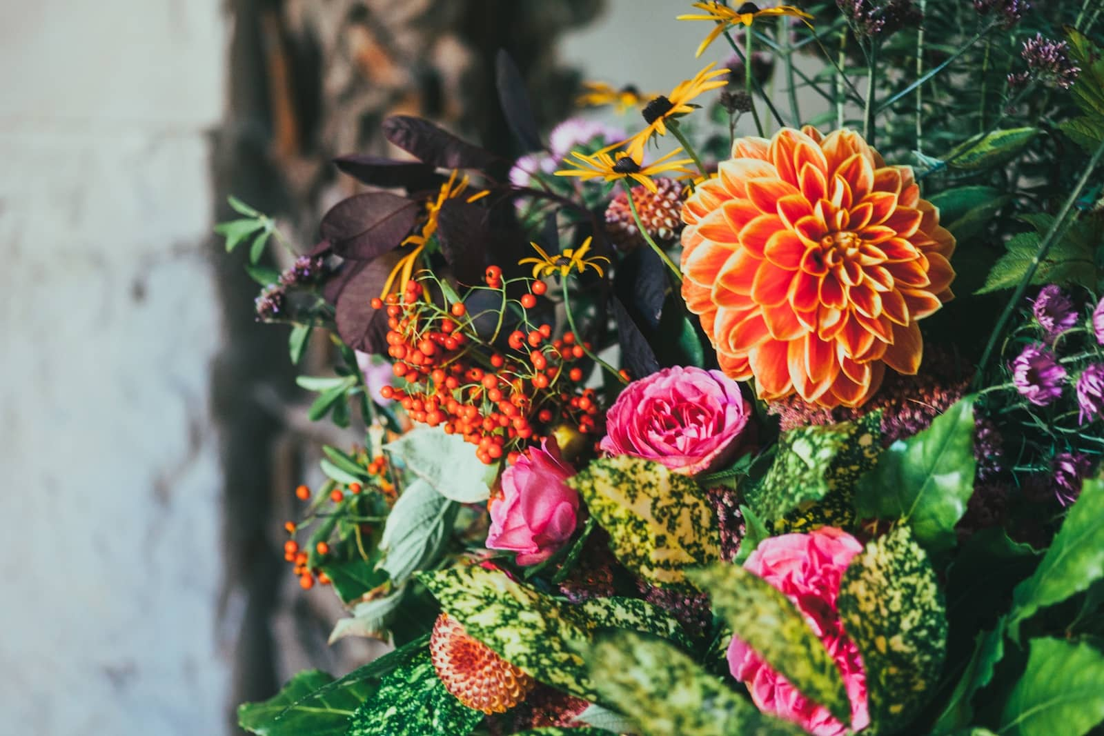 A bouquet of brightly coloured flowers of pink and orange