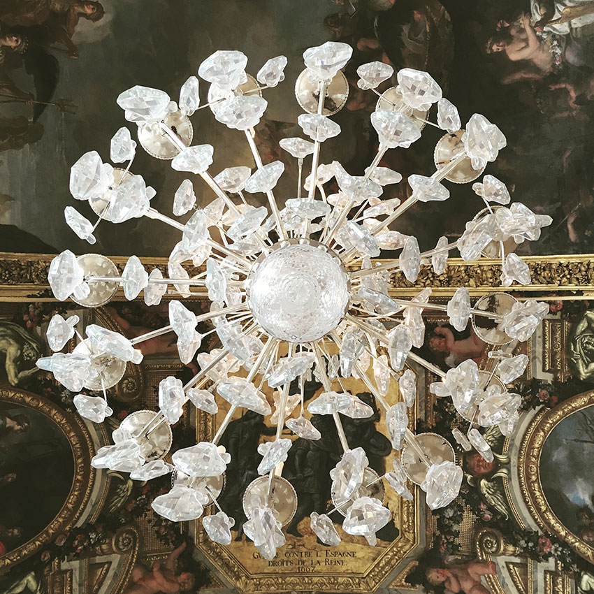 Shot from directly under a chandelier in the palace of Versailles