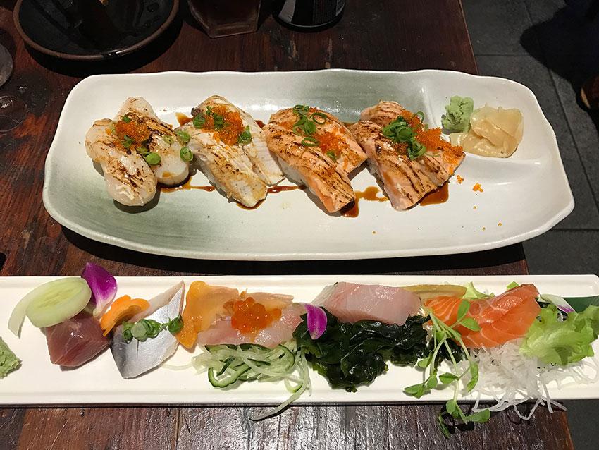Plate of sashimi and plate of aburi sushi