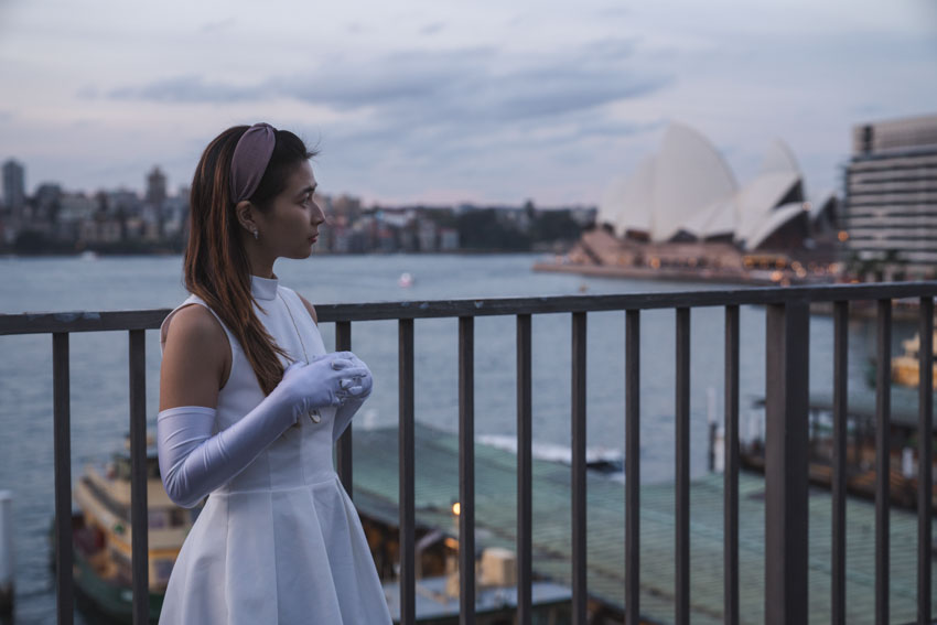 Medium shot of me with long white gloves and the Opera House in the background