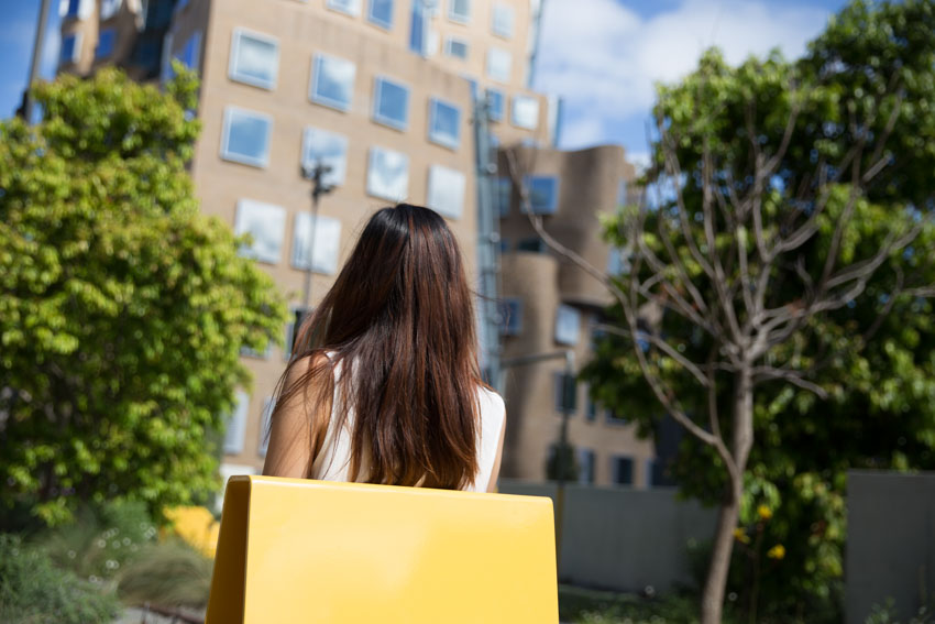 Shot from behind my head, of the back of my head with the university building in the background