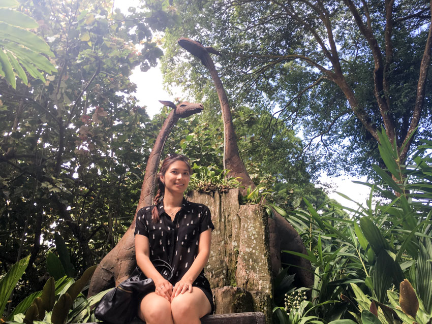 Low angle shot of me sitting in front of some giraffe sculptures