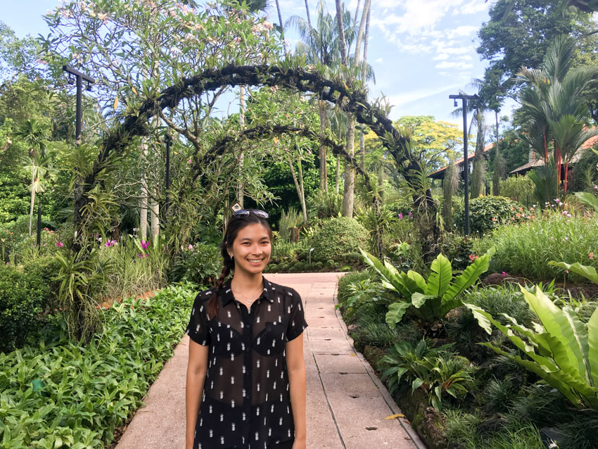 Medium shot of me standing on a path with some garden arches
