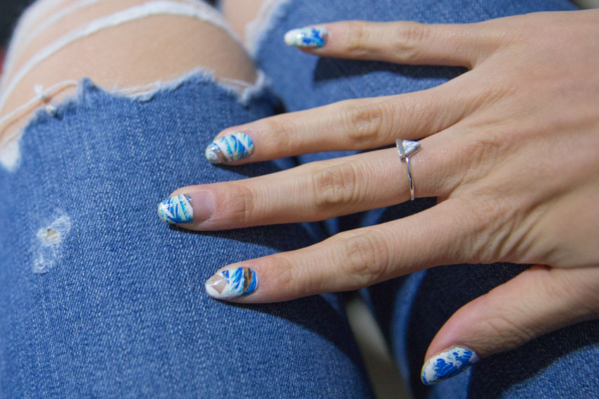 Close up shot of my ocean-patterned nail wraps