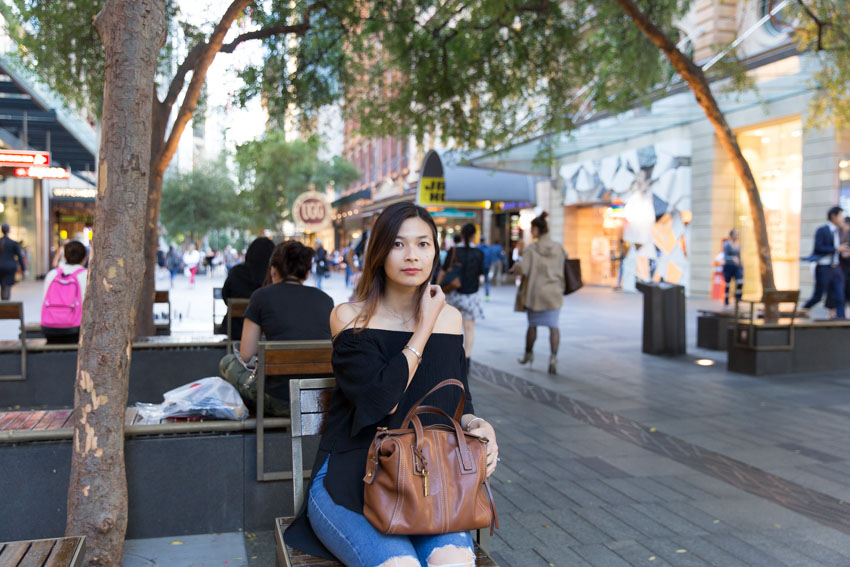 Me sitting on some interestingly-arranged seating in Pitt Street Mall