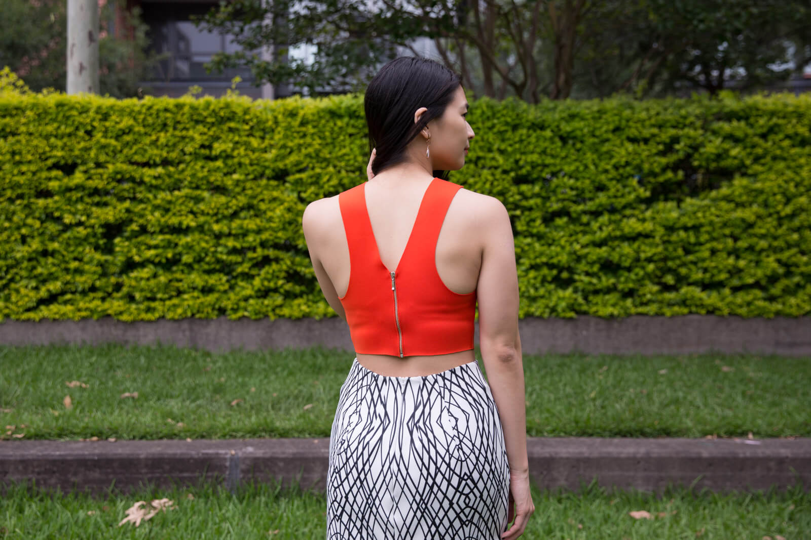 The same woman from other photos in this post, from the back, showing the back of her sleeveless top