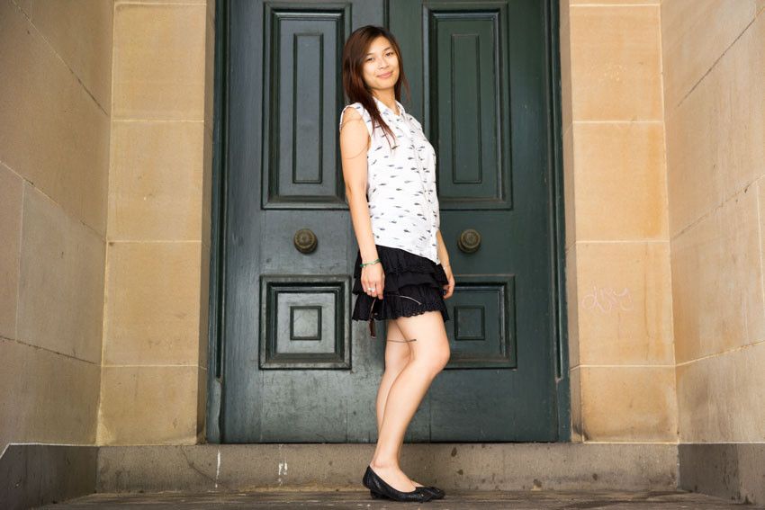 A full shot of me standing in front of an old green door.