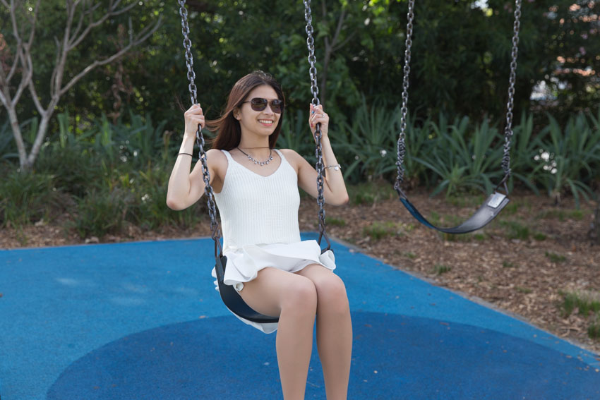 Me mid-swing on a chain swing