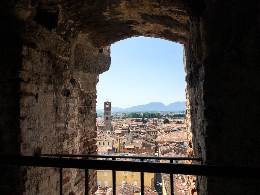 View of Lucca from a stone window in the Guinigi Tower
