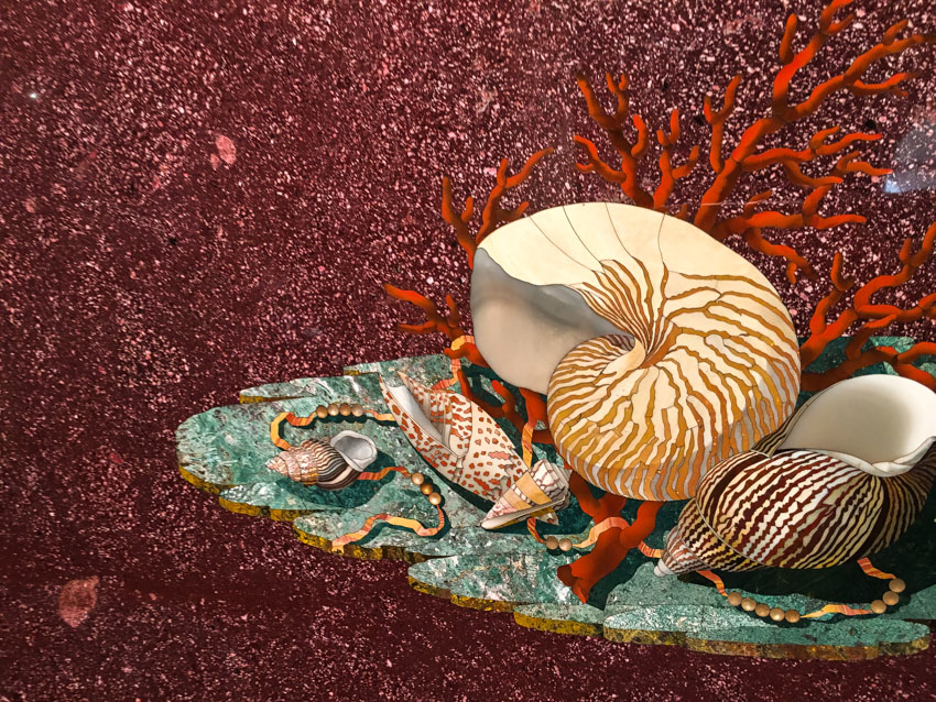 A detailed precious stone mosaic of a shell