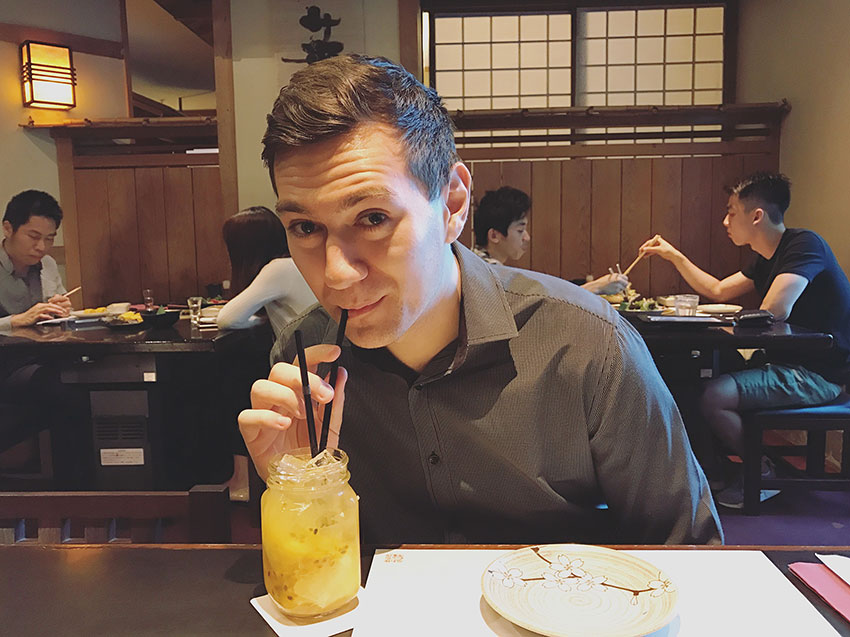 Nick drinking a cocktail