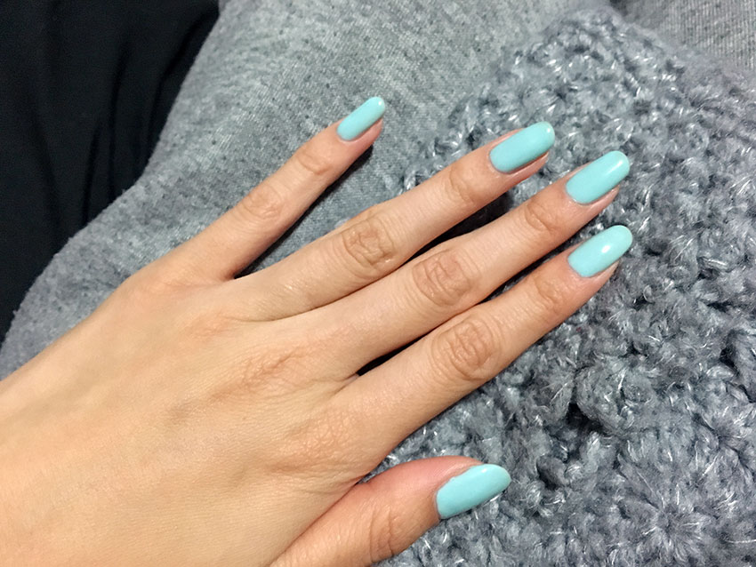 My nails painted a light baby blue