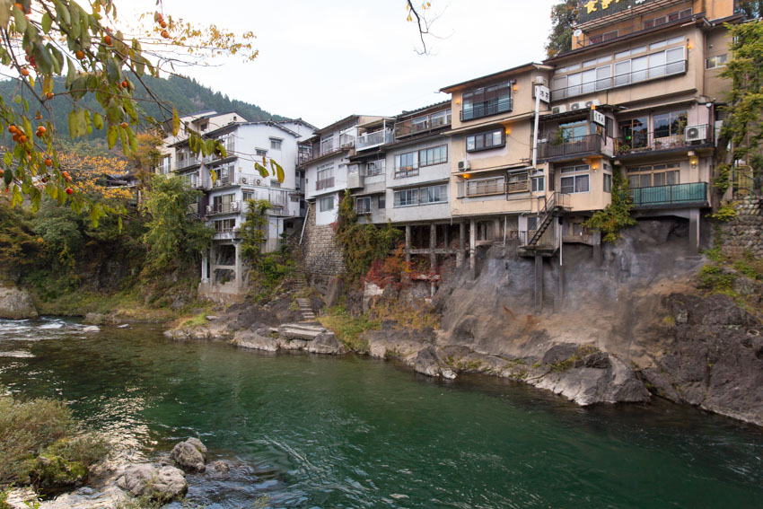 Some houses just above the river, with stone steps leading all the way down to the water's edge