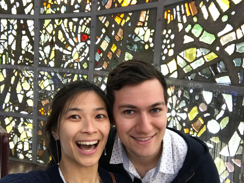 A selfie of me and Nick inside the tower with the stained glass in the background
