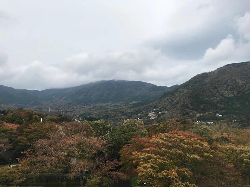 A scenic view of Hakone as seen from the top of the tower, with clouds filling the sky