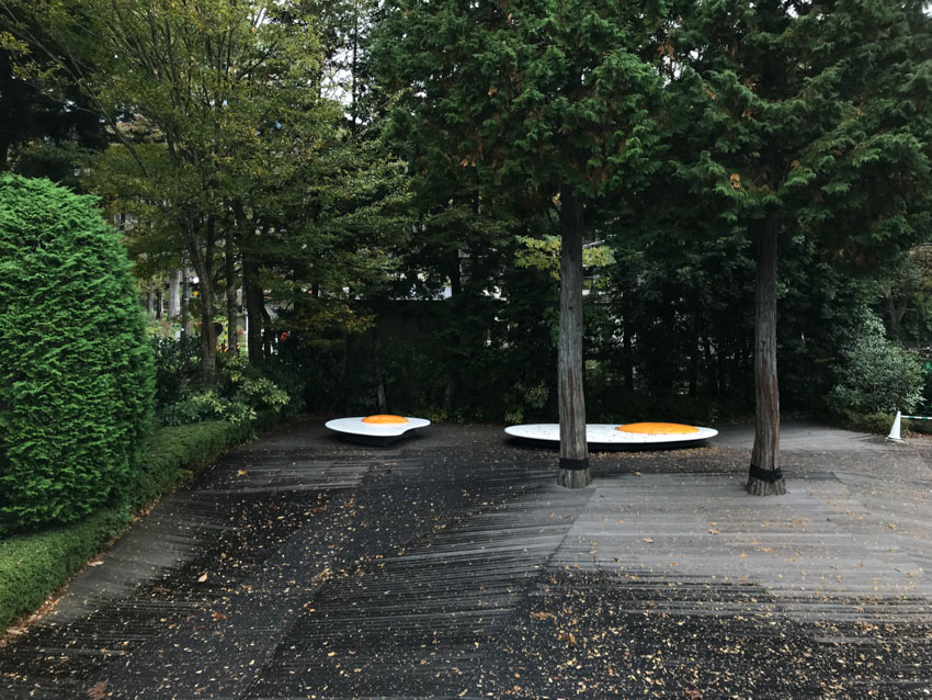 A sculpture that looked like two large fried eggs lying flat on the ground