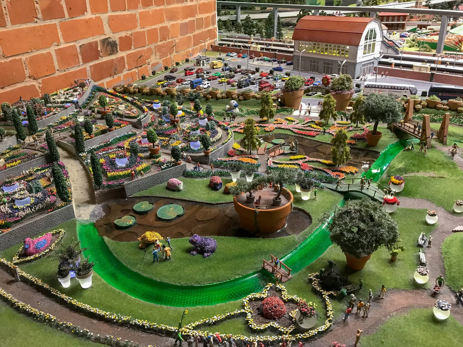 Another miniature replica of a garden with green lawns and tiny colourful plants