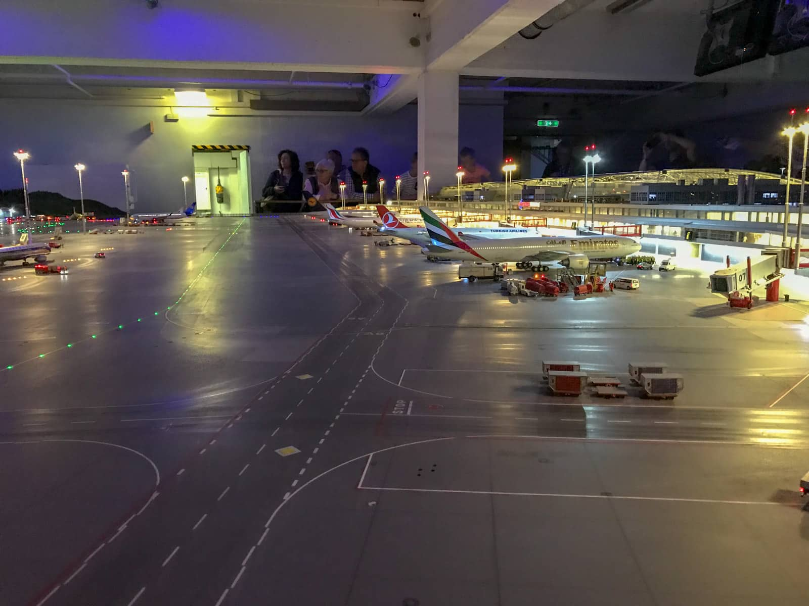 A model airport as part of an indoor model railway. The lights are off to simulate night-time