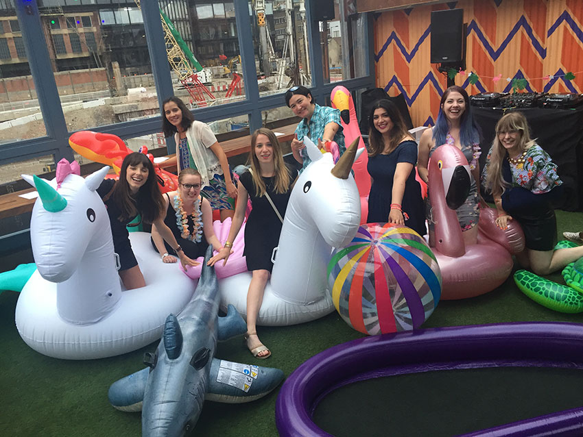 Amy and some of the girls from the Twitter team at their summer party with some inflatables