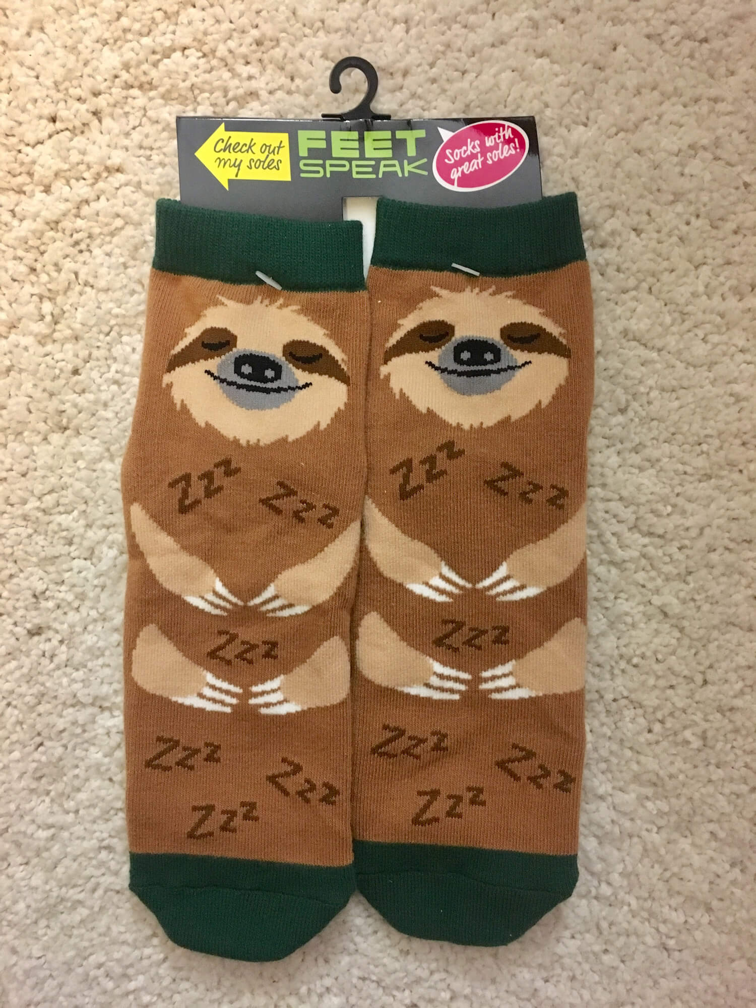A pair of socks made to look like sleeping sloths