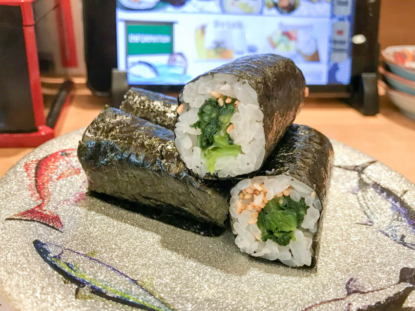 Three small sushi rolls of Hiroshima greens