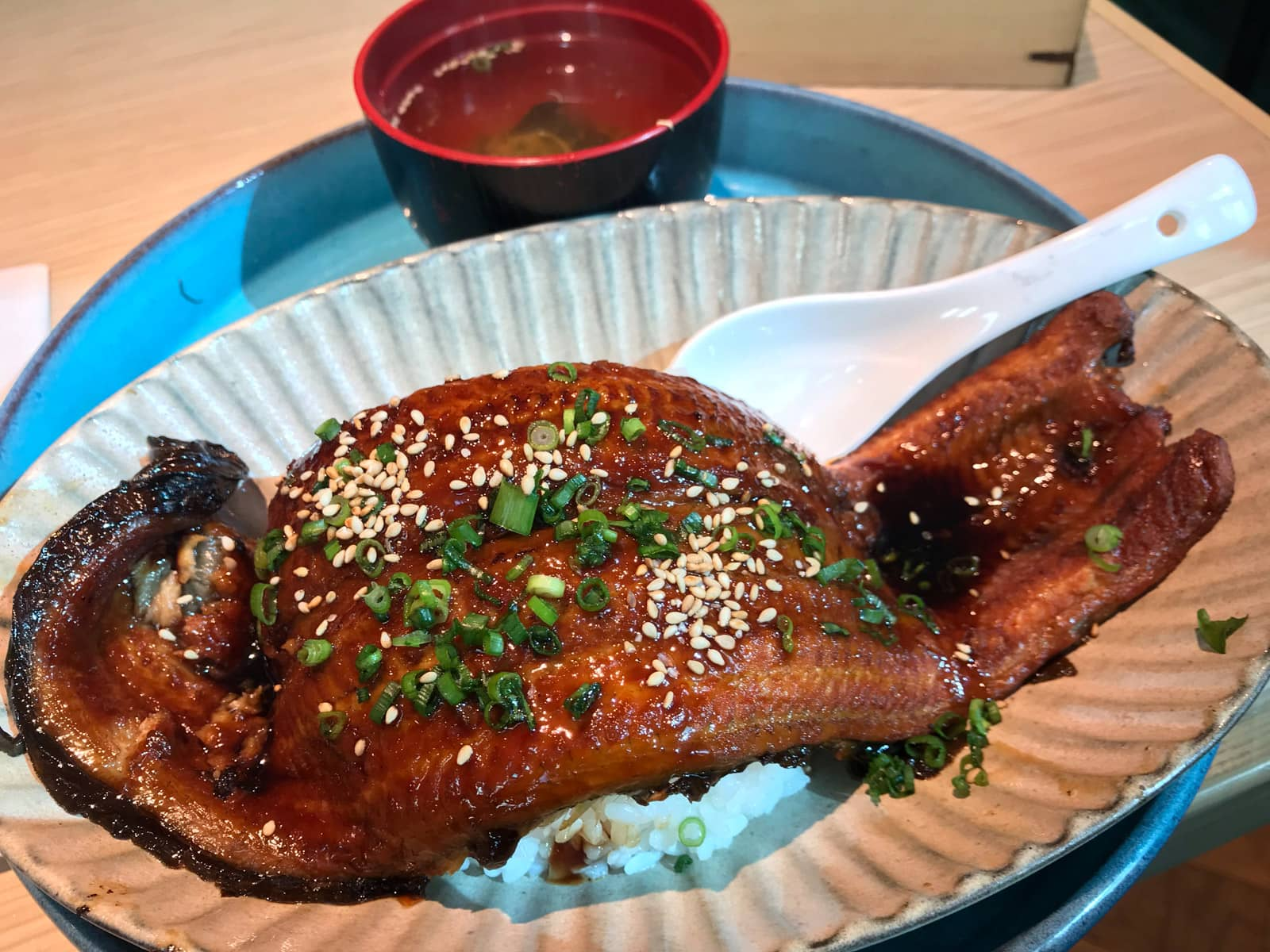 A large grilled eel (Japanese unagi) on a bed of white rice
