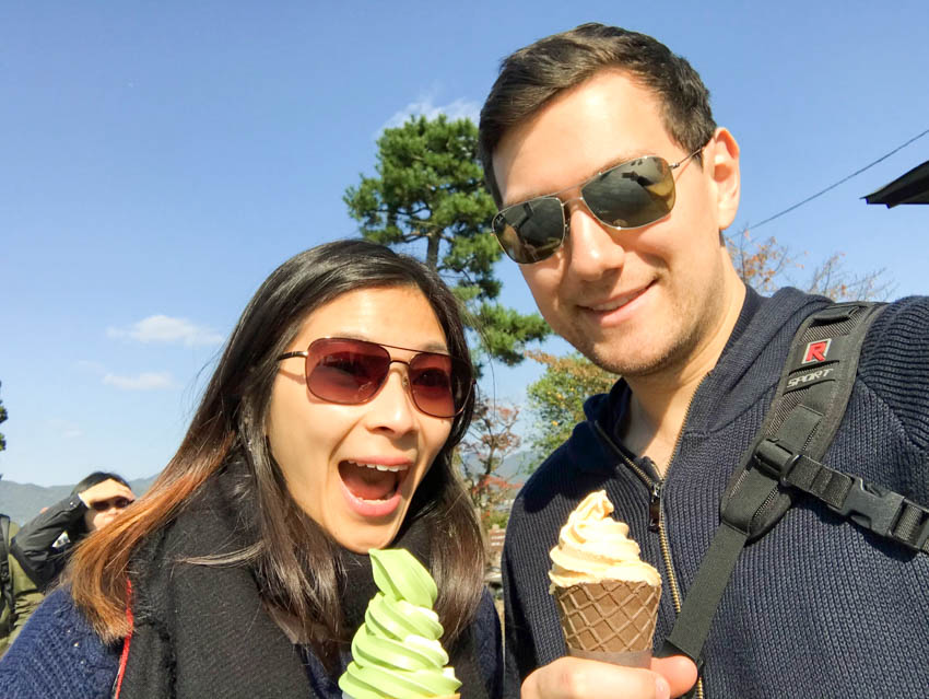 Me and Nick smiling with matcha (green tea) ice cream and caramel ice cream, respectively