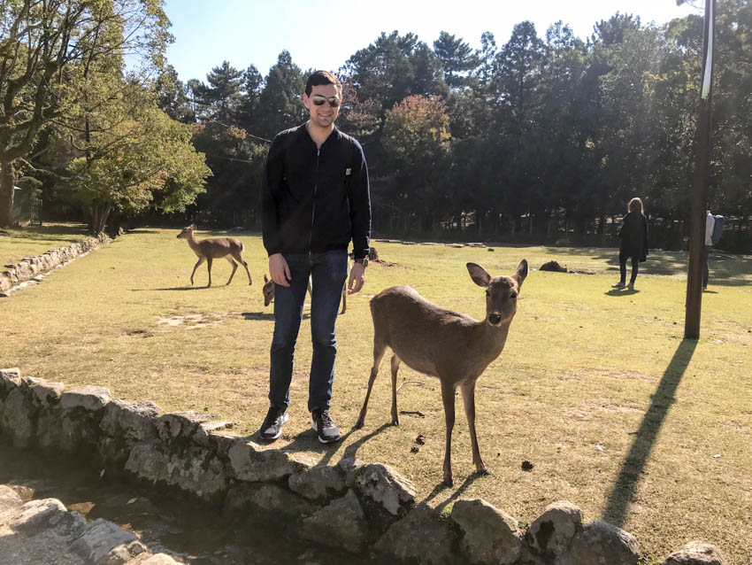 Nick standing next to a deer