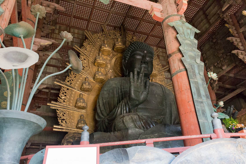 A big stone buddha located at the entrance of the temple