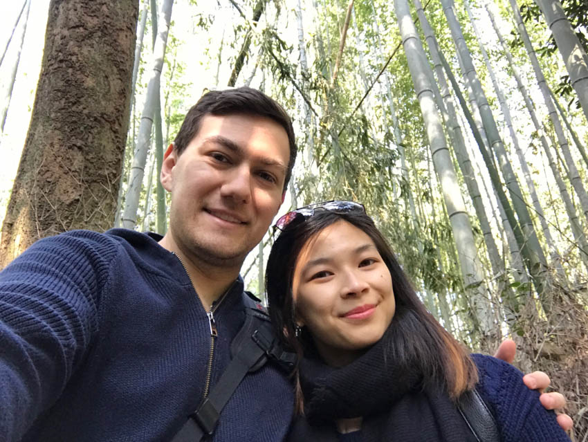 A selfie of myself and Nick with the Arashiyama bamboo rainforest behind us