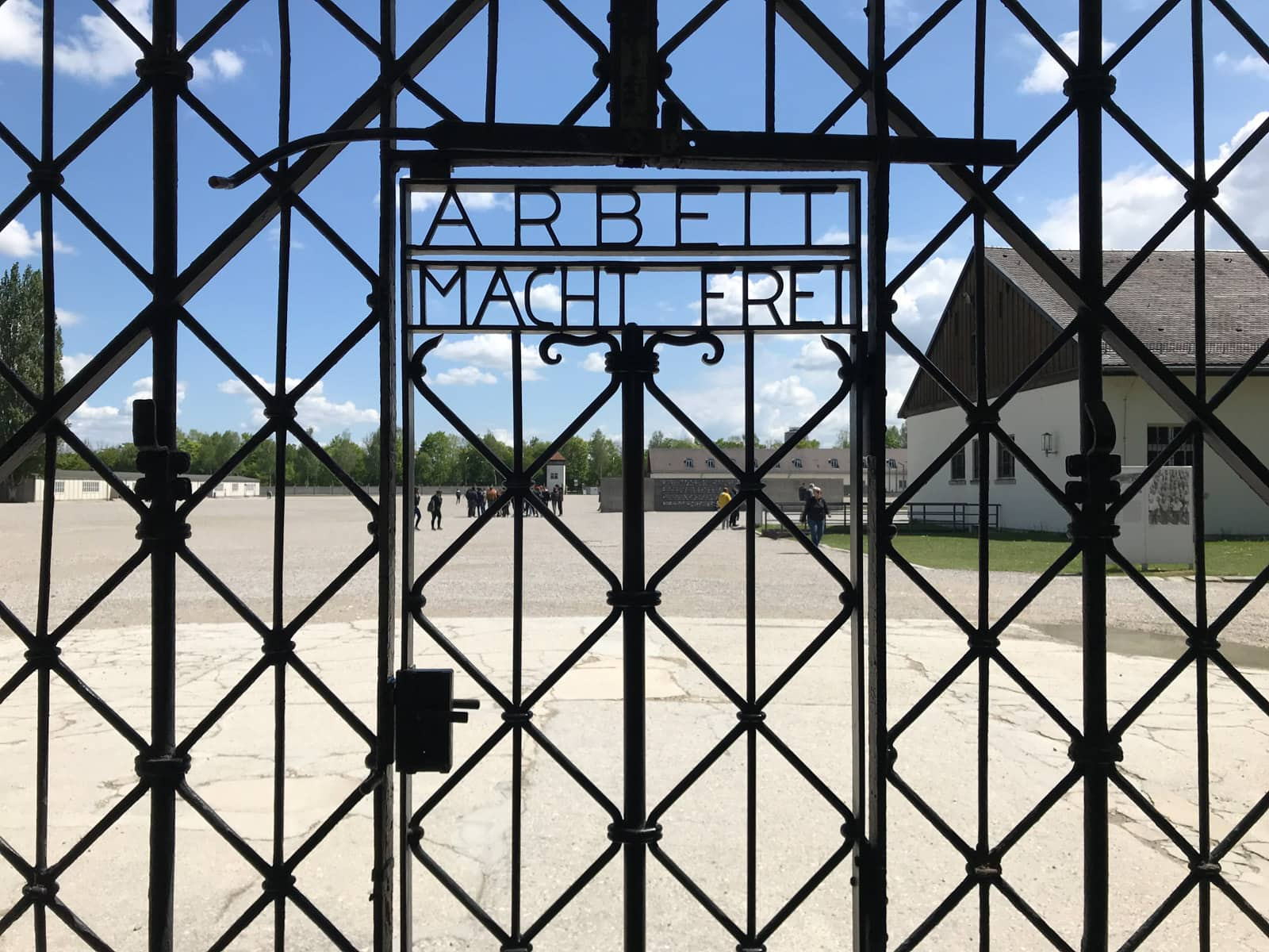 "The gate to a concentrattion camp, with metal letters reading ""Arbeit macht frei""."
