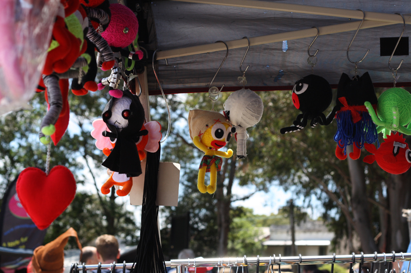 Cute voodoo dolls hanging from a stall