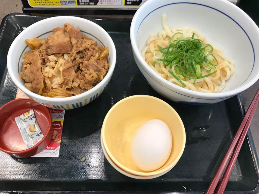 A tray with some chicken don (rice bowl), udon and miso soup