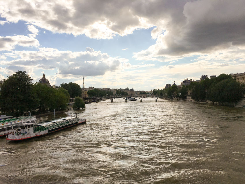 The Seine as seen from a bridge, with a cloudy afternoon sky