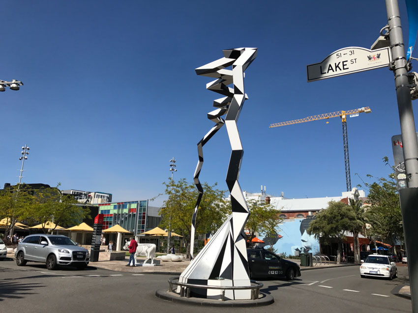 Black and white sculpture in the middle of a roundabout