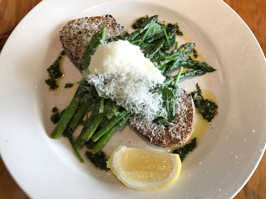 Asparagus, spinach and a poached egg with parmesan, on top of toast