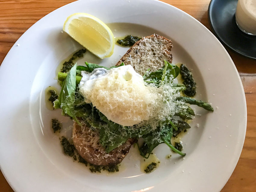 A plate of asparagus and poached egg on sourdough