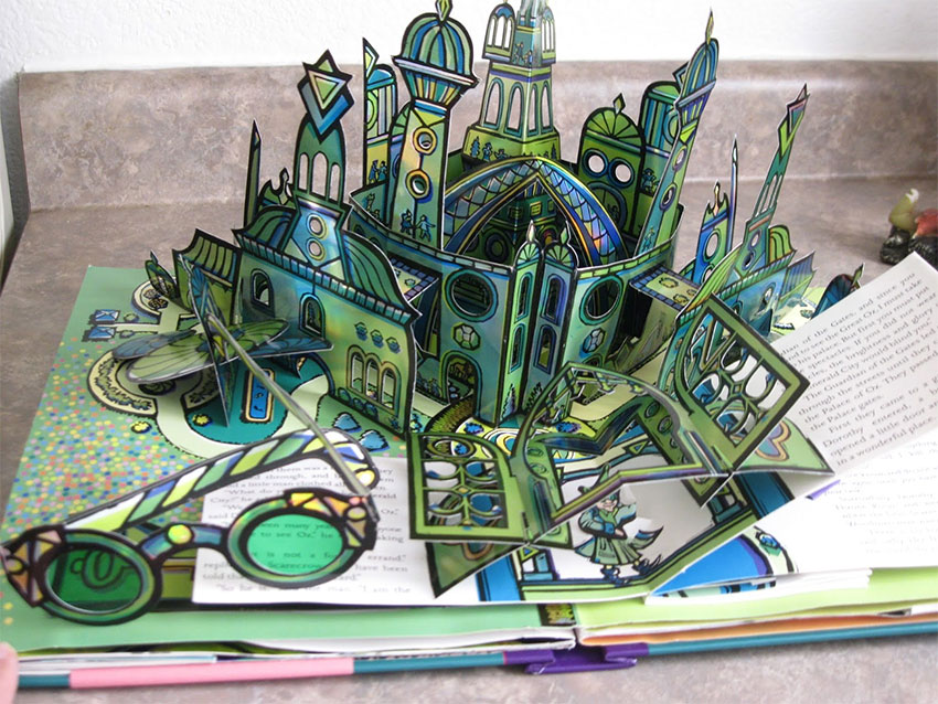 A pretty complex pop-up book of a green-and-blue coloured castle