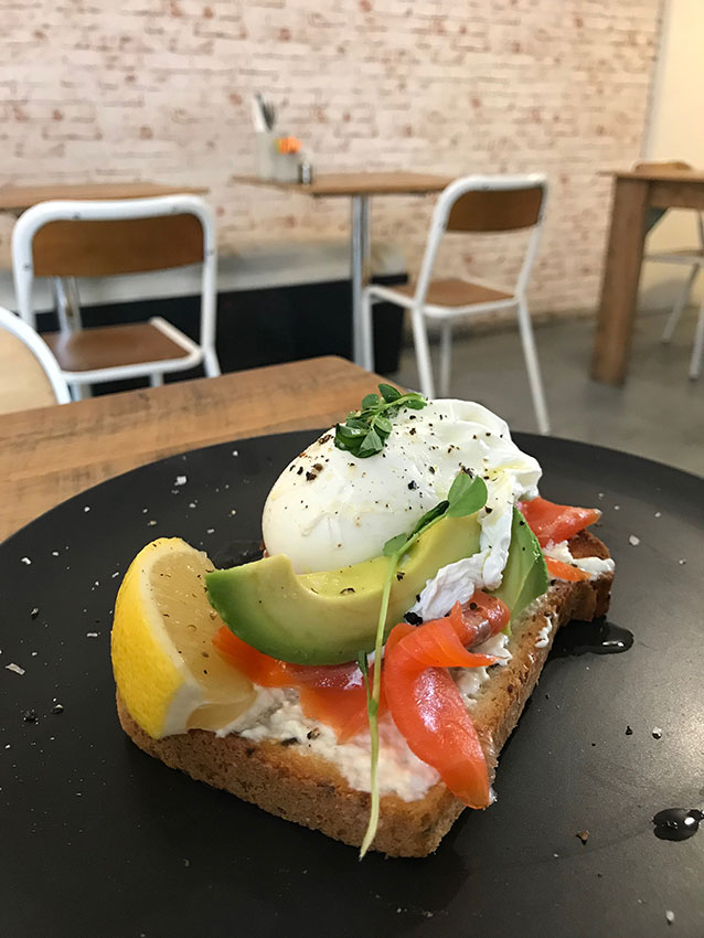 Smoked salmon, a poached egg, and avocado on gluten free bread