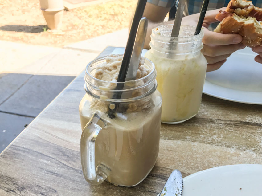 Iced chai in a square jar with a handle