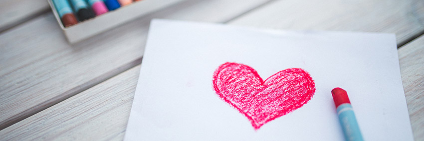 Love heart drawn on paper with crayon