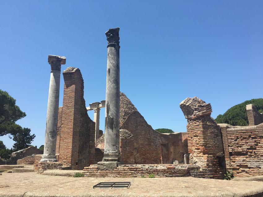 Stone pillars by a broken-down building