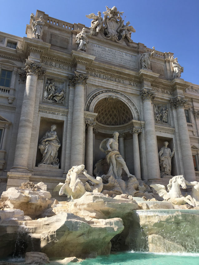 Trevi Fountain during the afternoon, stone figures visible