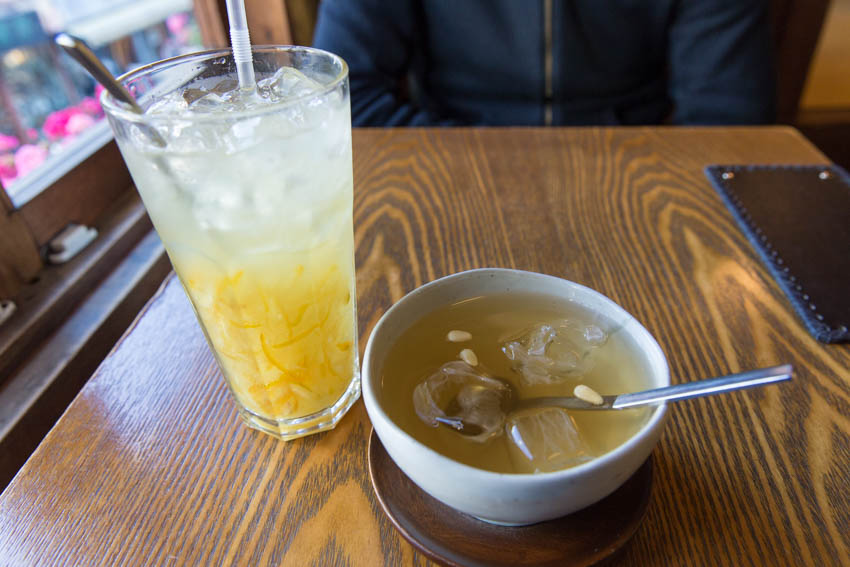 A glass of yuzu ice tea and a cup of plum tea