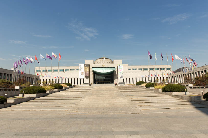 The war memorial entrance with the flags of various nations