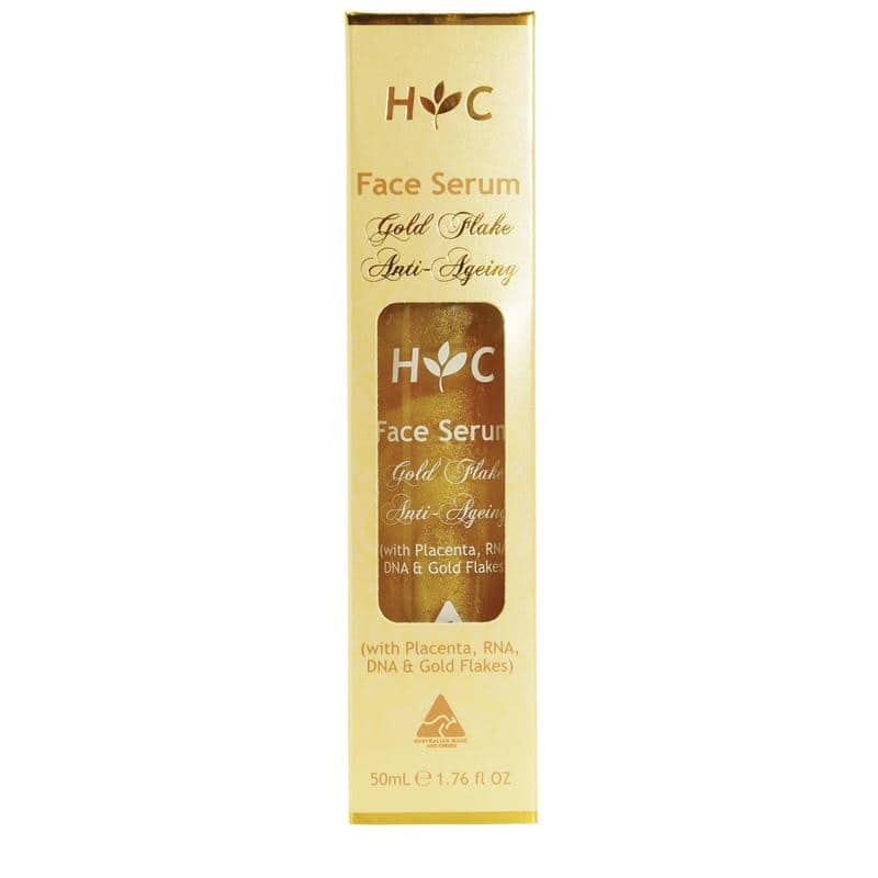 A yellow box with a skincare product inside that is gold in colour. It's labelled as gold flake anti-ageing serum