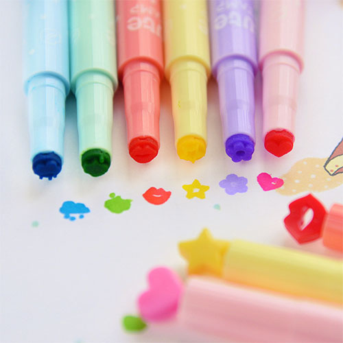 Cheap stamp markers alongside their corresponding stamp on paper