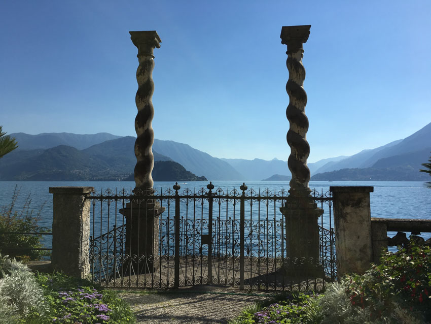 Close up shot of the two twisted pillars at Villa Monastero, with the lake in the background