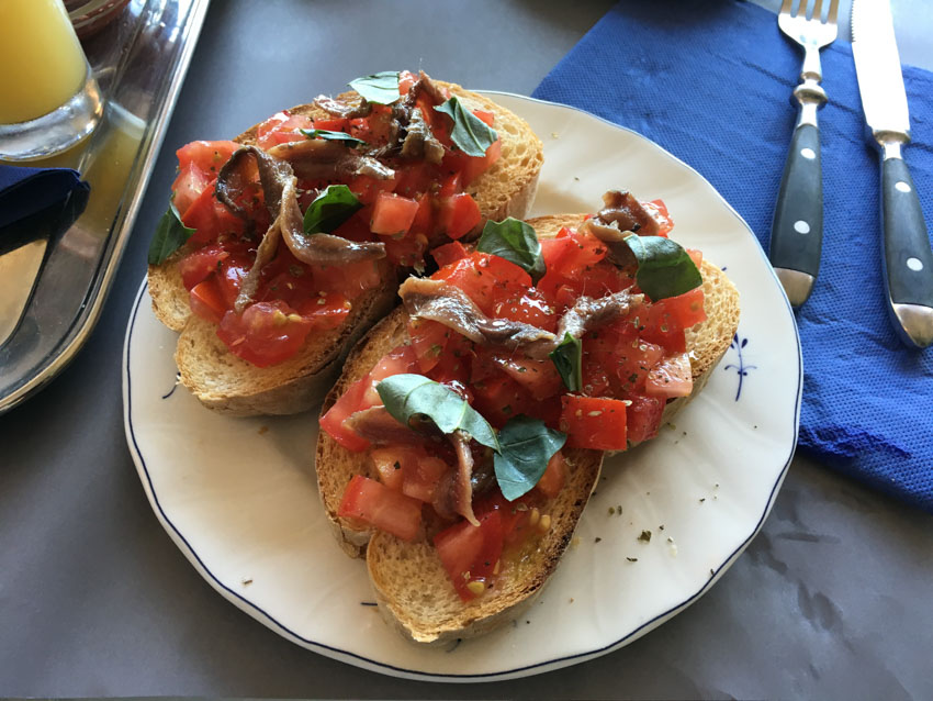 Tomato and anchovy bruschetta for breakfast