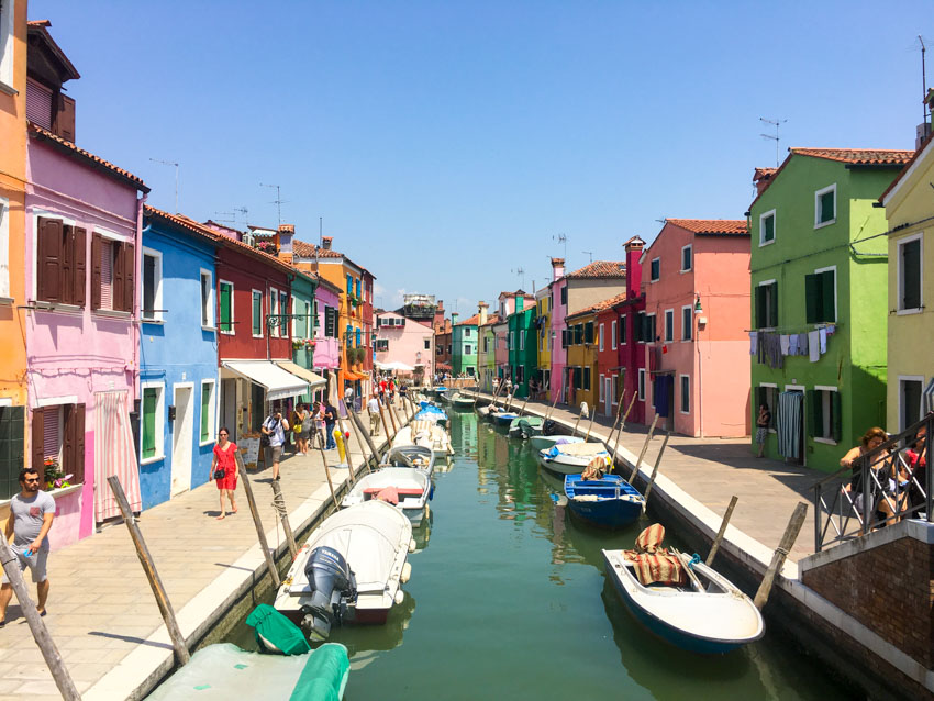 A waterway in Burano with coloured houses down the sides